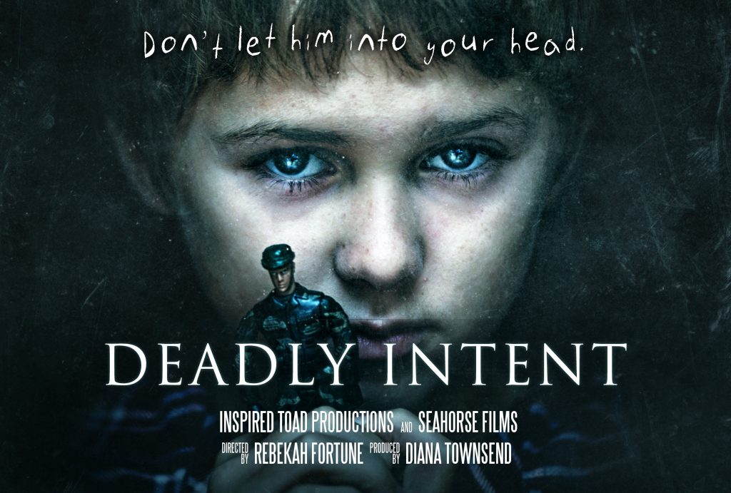 """Deadly Intent Movie Poster - a child looks intensely at the camera while holding a toy soldier. Text reads: """"Don't let him into your head."""""""