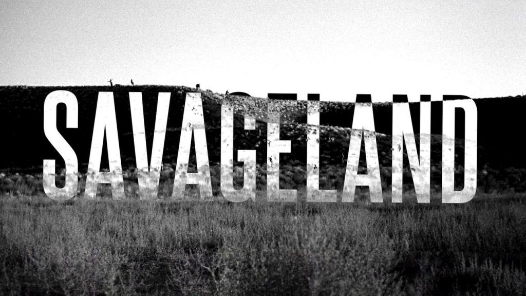 """""""Savageland"""" written in all caps across a moody black-and-white background. Silhouettes of people spread along the horizon hint at the approaching danger."""